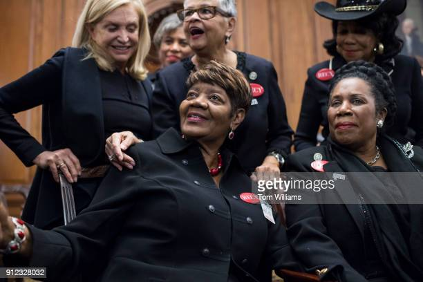 Rose Gunter center the niece of sexual assault survivor Recy Taylor wear all black during a photo op in the Capitol's Rayburn Room to show solidarity...