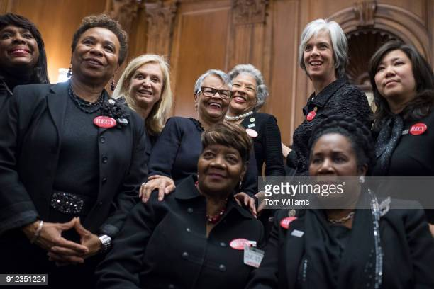 Rose Gunter front and center the niece of sexual assault survivor Recy Taylor wears black during a photo op in the Capitol's Rayburn Room to show...
