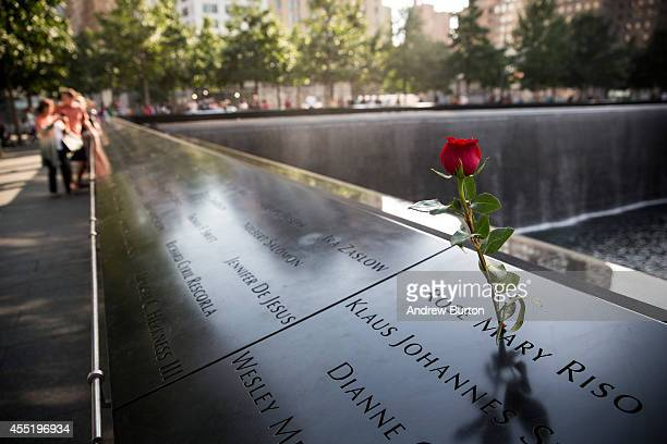 A rose is left in rememberance of Rose Mary Riso a victim of the September 11th terrorist attacks at the National September 11 Memorial on September...