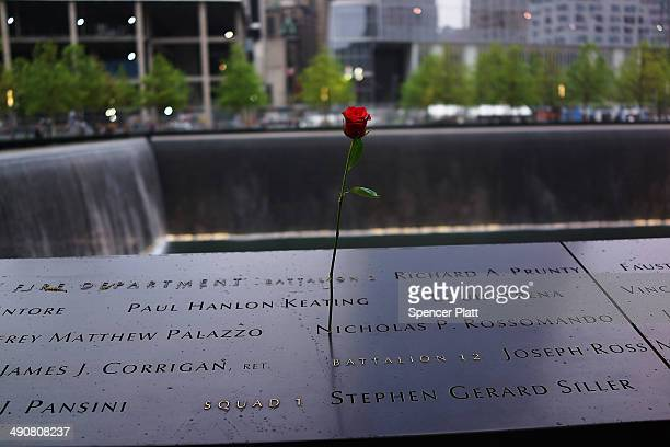 A rose is placed on a name engraved along the South reflecting pool at the Ground Zero memorial site during the dedication ceremony of the National...