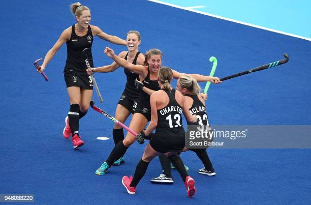 Rose Keddell of New Zealand is congratulated by her teammates after scoring their second goal during the Women's Gold Medal match between Australia...