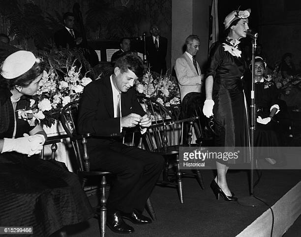 Rose Kennedy introduces her son, John, who is waiting to make a campaign speech.