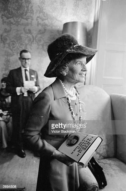 Rose Kennedy, the wife of Joseph Kennedy and mother of the Democratic Party politicians John, Robert and Edward Kennedy, holding a copy of her...