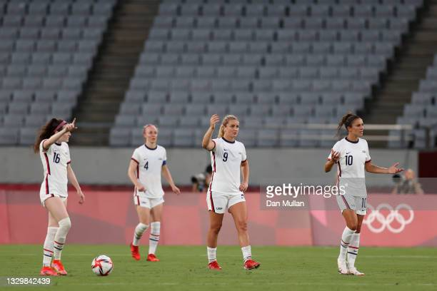 Rose Lavelle, Lindsey Horan and Carli Lloyd of Team United States look dejected after conceding a second goal scored by Stina Blackstenius of Team...
