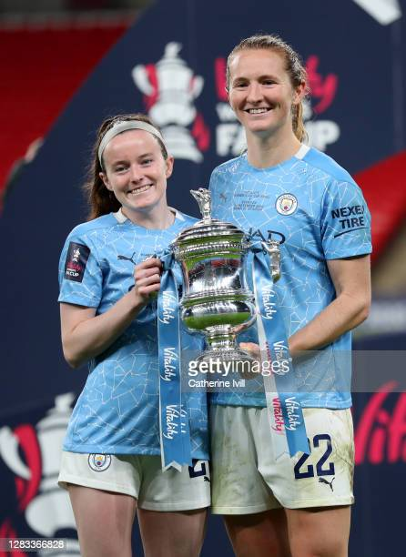 Rose Lavelle of Manchester City and Sam Mewis of Manchester City celebrate with the Vitality Women's FA Cup Trophy following their team's victory in...