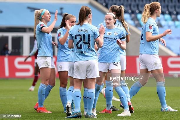 Rose Lavelle of Manchester City celebrates with teammates after scoring their team's sixth goal during the Vitality Women's FA Cup Fourth Round match...