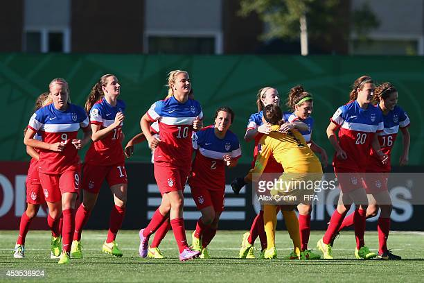Rose Lavelle of the United States celebrates her team's third goal with team mates during the FIFA U20 Women's World Cup Canada 2014 group B match...