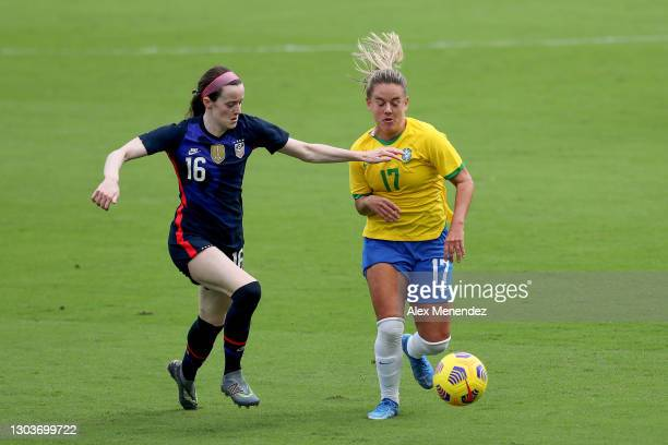 Rose Lavelle of the United States defends against Andressinha of Brazil during the SheBelieves Cup at Exploria Stadium on February 21, 2021 in...