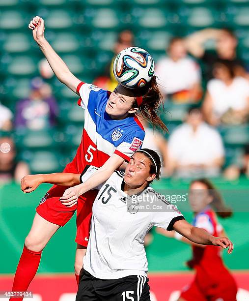 Rose Lavelle of the United States wins a header over Wibke Meister of Germany at Commonwealth Stadium on August 5 2014 in Edmonton Canada