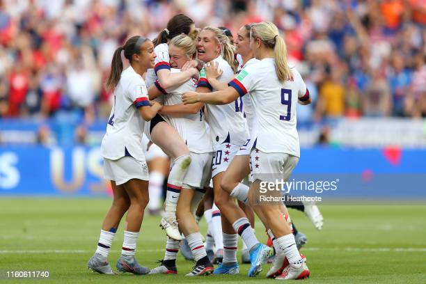 Rose Lavelle of the USA celebrates with Emily Sonnett and teammates following the 2019 FIFA Women's World Cup France Final match between The United...