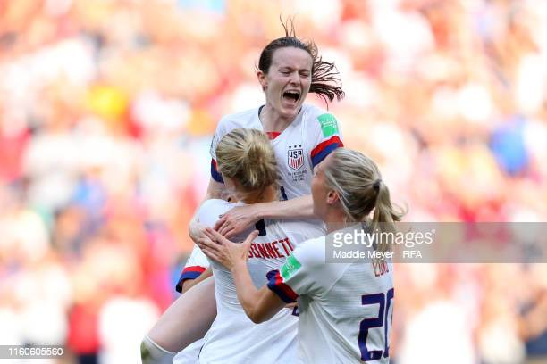 Rose Lavelle of the USA celebrates with teammates Emily Sonnett and Allie Long following the 2019 FIFA Women's World Cup France Final match between...