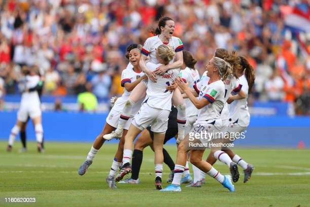 Rose Lavelle of the USA celebrates with teammates following the 2019 FIFA Women's World Cup France Final match between The United States of America...