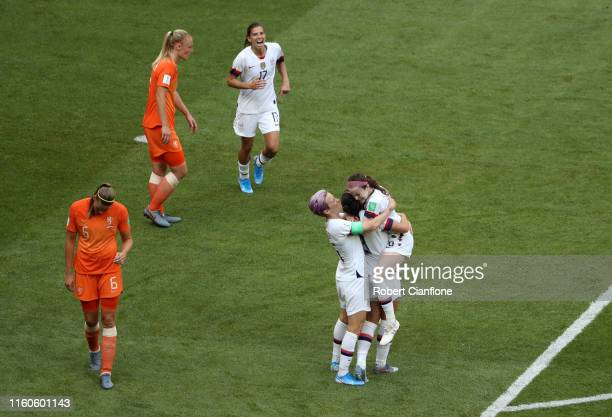 Rose Lavelle of the USA celebrates with teammates Megan Rapinoe and Alex Morgan after scoring her team's second goal during the 2019 FIFA Women's...