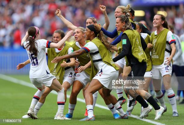 Rose Lavelle of the USA celebrates with teammates on the bench after scoring her team's second goal during the 2019 FIFA Women's World Cup France...