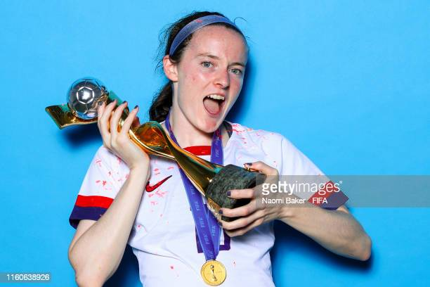 Rose Lavelle of the USA poses with the Women's World Cup trophy after the 2019 FIFA Women's World Cup France Final match between The United State of...