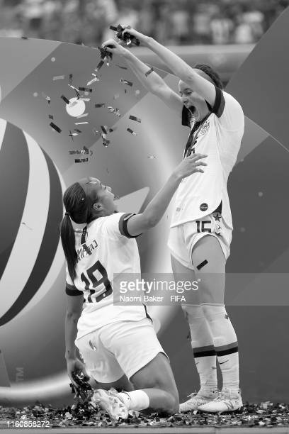 Rose Lavelle of the USA sprinkles confetti over Mallory Pugh of the USA after their teams victory in the 2019 FIFA Women's World Cup France Final...