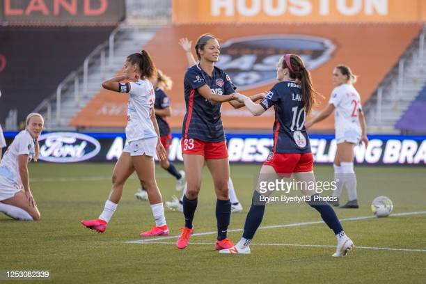 Rose Lavelle of Washington Spirit and Ashley Hatch celebrate during a game between Washington Spirit and Chicago Red Stars at Zions Bank Stadium on...