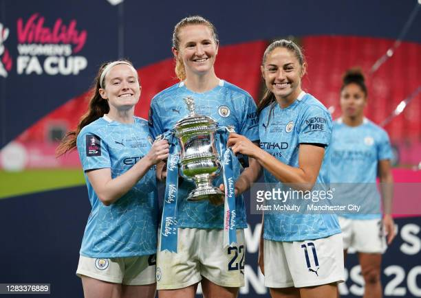 Rose Lavelle, Sam Mewis and Janine Beckie of Manchester City celebrate with the trophy during the Vitality Women's FA Cup Final match between Everton...
