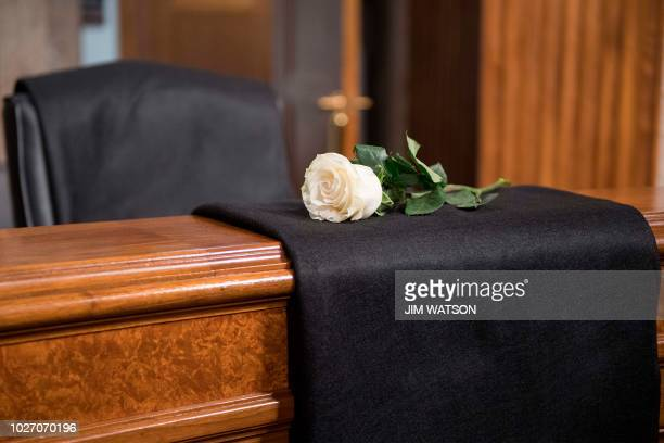Rose lays at the empty seat of former US Senator John McCain at the Senate Intelligence Committee on Capitol Hill in Washington, DC, on September 5,...