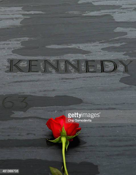 A rose left by family members sits on top of former US President John F Kennedy's grave marker at Arlington National Cemetery November 22 2013 in...