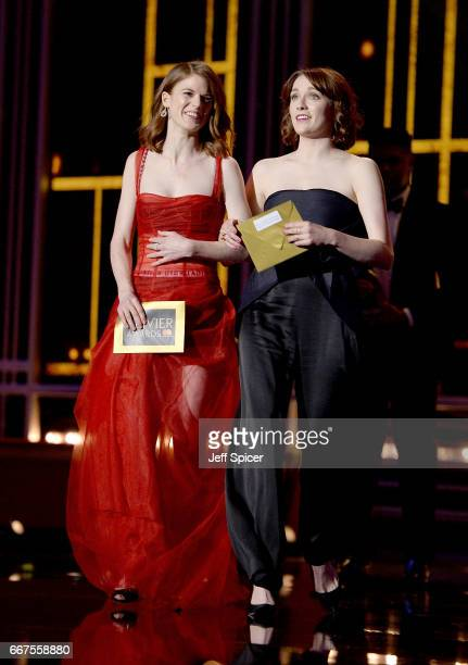 Rose Leslie and Charlotte Ritchie present an award on stage during The Olivier Awards 2017 at Royal Albert Hall on April 9 2017 in London England