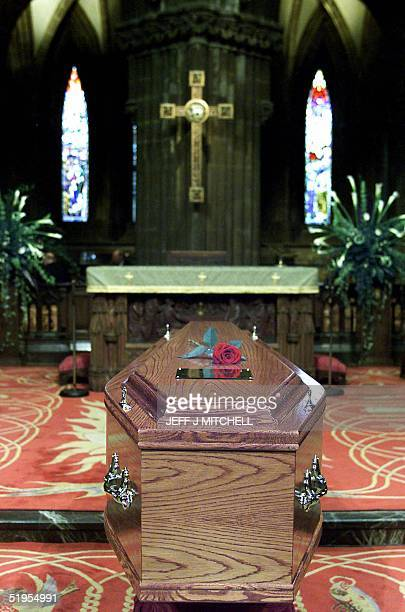 Rose lies on the coffin containing Scotland's First Minister Donald Dewar in Glasgow Cathederal prior to the funeral service 18 October 2000....