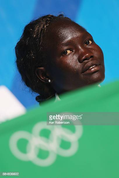 Rose Lokonyen of the Olympic Refugee Team talks while attending a press conference given by the Olympic Refugee Team on July 31, 2016 in Rio de...