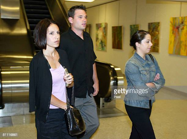 Rose Marie Rocha and Amy Rocha sisterinlaw and sister respectively of Laci Peterson leave with an unidentified man at the end of the day from the...