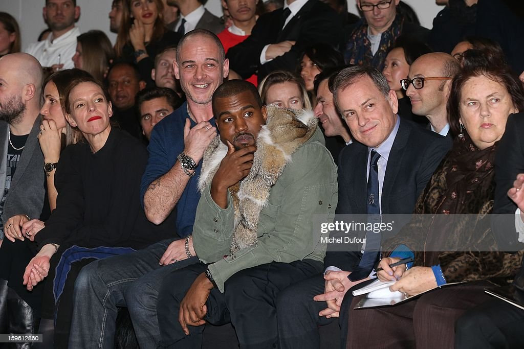 Rose Mary Ferguson, Tiphaine, Dino Chapman, Kanye West and Michael Burke attend the Louis Vuitton Men Autumn / Winter 2013 show as part of Paris Fashion Week on January 17, 2013 in Paris, France.