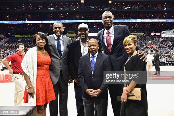 Rose Mutombo Former NBA players Steve SmithDennis Scott Congessman John LewisDikembe Mutombo and Millie Smith attend Boston Celtics vs Atlanta Hawks...