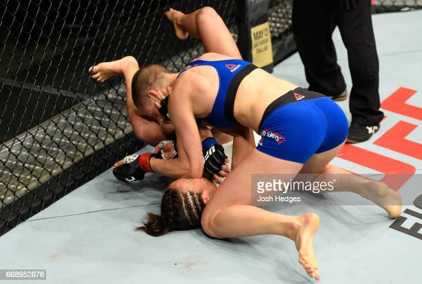 Rose Namajunas elbows Michelle Waterson in their women's strawweight fight during the UFC Fight Night event at Sprint Center on April 15, 2017 in...