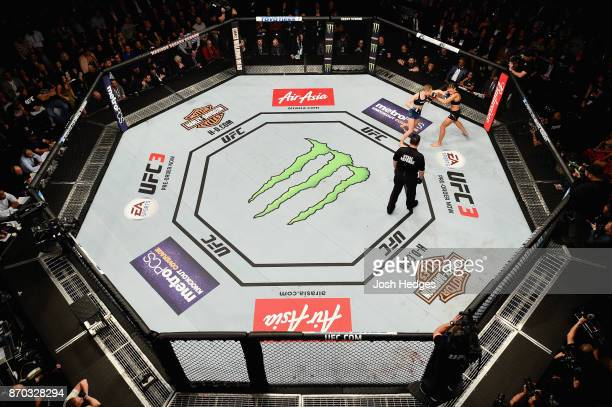 Rose Namajunas fights Joanna Jedrzejczyk of Poland in their UFC women's strawweight championship bout during the UFC 217 event at Madison Square...