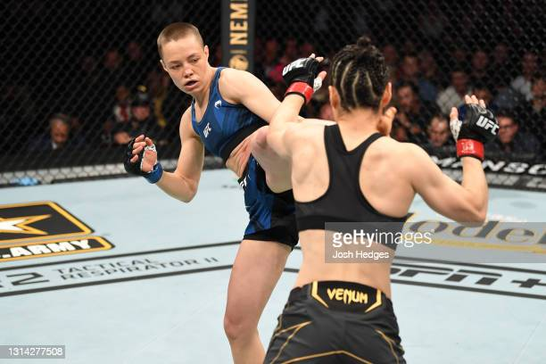Rose Namajunas kicks Zhang Weili of China in their UFC women's strawweight championship bout during the UFC 261 event at VyStar Veterans Memorial...