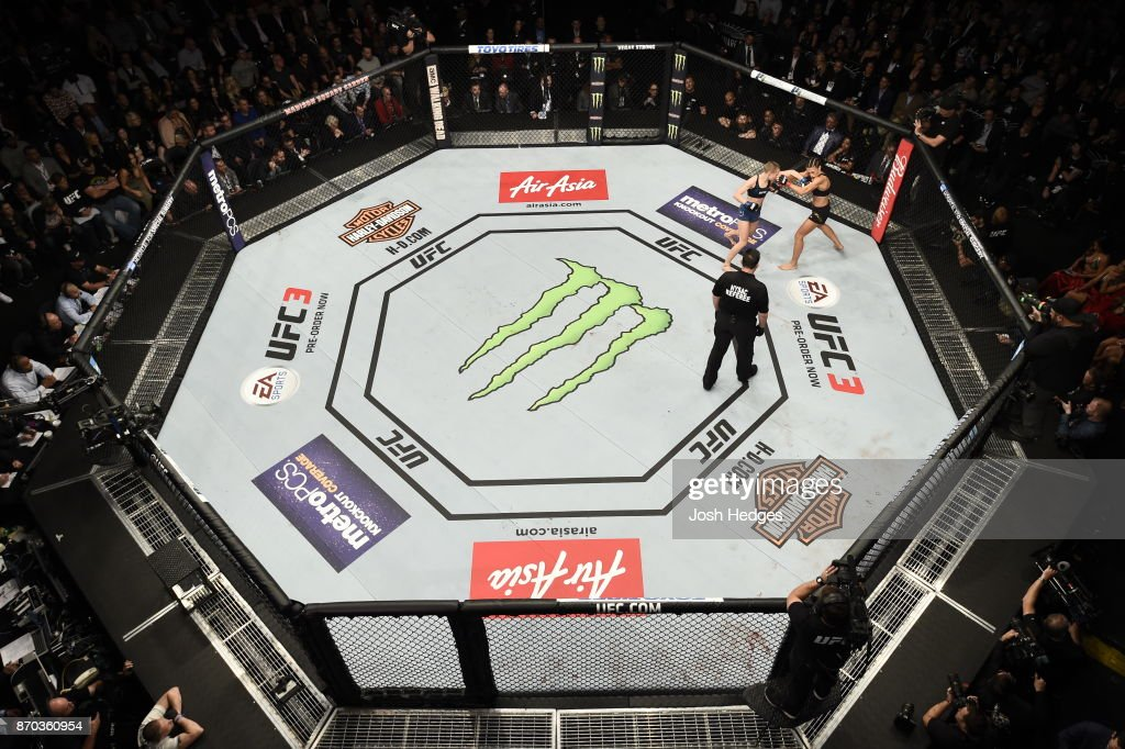 Rose Namajunas lands a punch against Joanna Jedrzejczyk of Poland in their UFC women's strawweight championship bout during the UFC 217 event at Madison Square Garden on November 4, 2017 in New York City.