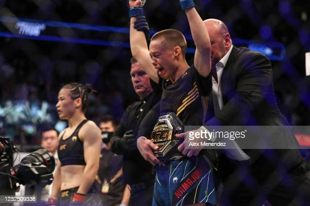 Rose Namajunas of the United States celebrates after beating Zhang Weili of China during the Women's Strawweight Title bout of UFC 261 at VyStar...