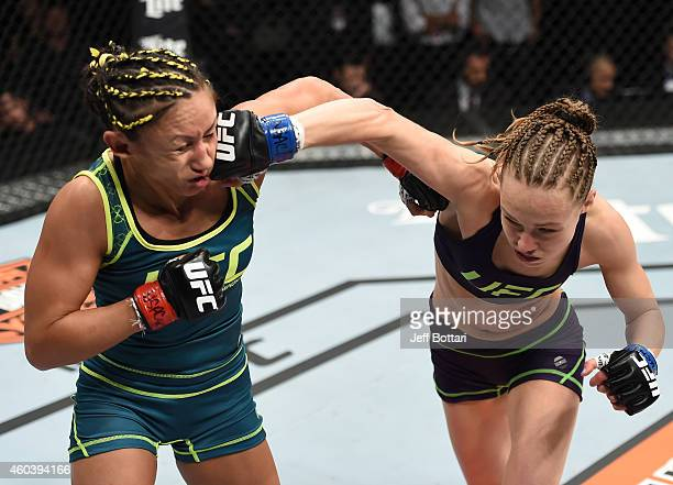 Rose Namajunas punches Carla Esparza in their strawweight championship fight during The Ultimate Fighter Finale event inside the Pearl concert...