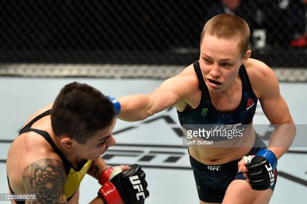 Rose Namajunas punches Jessica Andrade of Brazil in their strawweight fight during the UFC 251 event at Flash Forum on UFC Fight Island on July 12,...