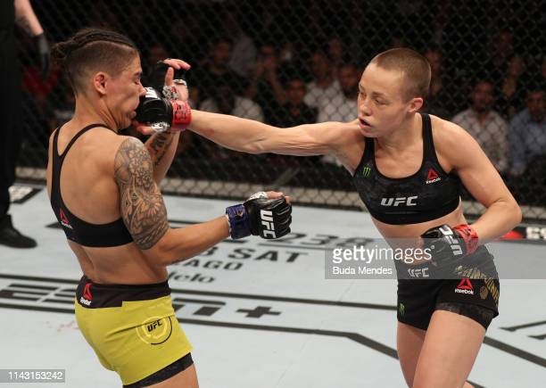 Rose Namajunas punches Jessica Andrade of Brazil in their women's strawweight championship bout during the UFC 237 event at Jeunesse Arena on May 11,...