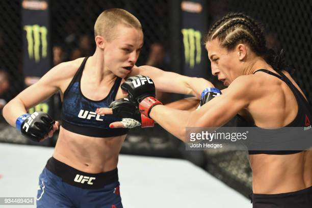 Rose Namajunas punches Joanna Jedrzejczyk of Poland in their UFC women's strawweight championship bout during the UFC 217 event inside Madison Square...