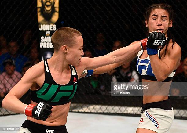 Rose Namajunas punches Tecia Torres in their women's strawweight bout during the UFC Fight Night event at Amalie Arena on April 16 2016 in Tampa...