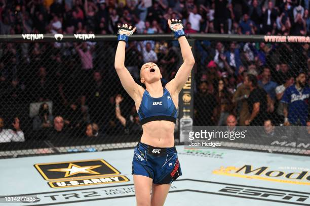Rose Namajunas reacts after defeating Zhang Weili of China in their UFC women's strawweight championship bout during the UFC 261 event at VyStar...