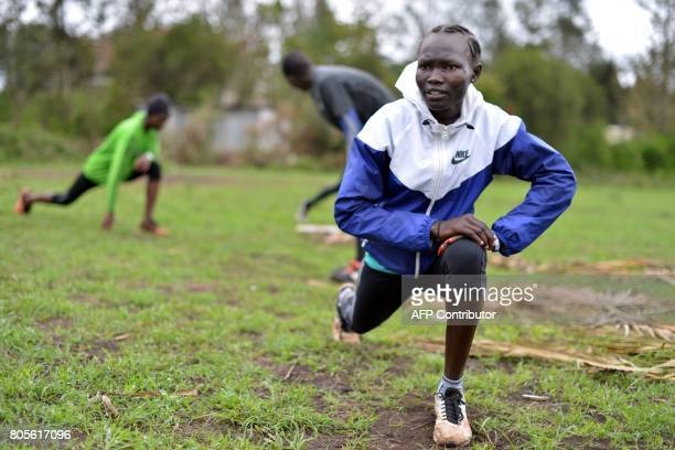 Rose Nathike Lokonyen, a South Sudanese refugee and 800m Olympian at the Rio Olympic Games stretches alongside fellow refugees on May 12, 2017 during...