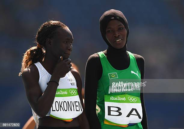 Rose Nathike Lokonyen of Refugee Olympic Team and Houleye Ba of Mauritania in discussion prior to the Women's 800 metres heats on Day 12 of the Rio...