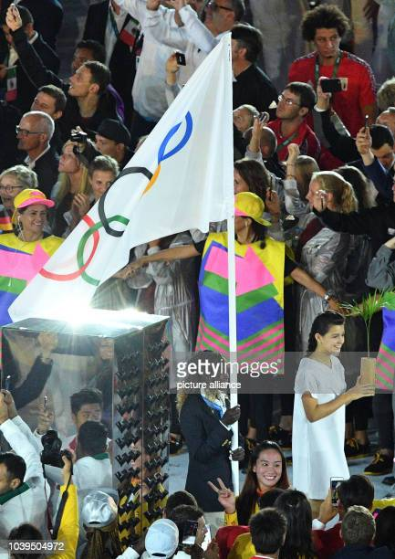Rose Nathike Lokonyen South Sudanese refugee carries the flag of the Refugee Olympic Team during the opening ceremony of the Rio 2016 Olympic Games...