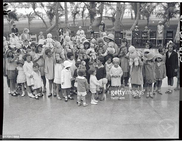 Rose O'Neill creator of the Kewpie Doll shown with children and dolls