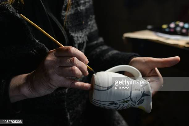 Rose O'Toole paints and decorates by hand on ceramics and pottery made by her husband Seamus at the closed Roundstone Ceramics craft center on the...