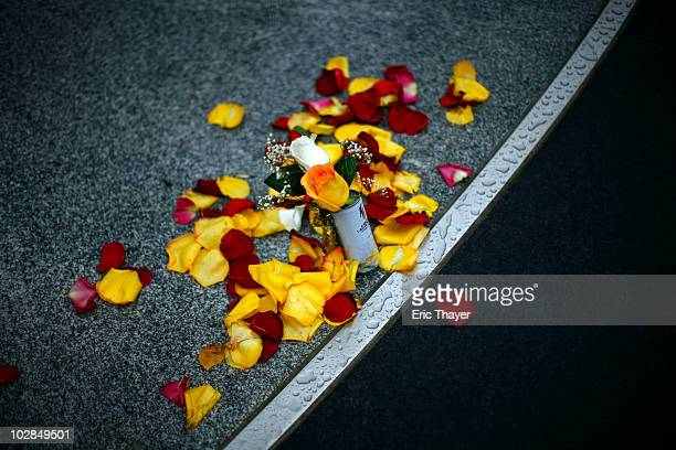 Rose petals and a rose are placed in front of Gate 4 at Yankee Stadium after the death of George Steinbrenner July 13 2010 in the Bronx borough of...