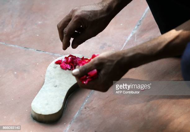 Rose petals are placed on the raised steps of the path of the last steps of Indian independence icon Mahatma Gandhi ahead of the visit by US...