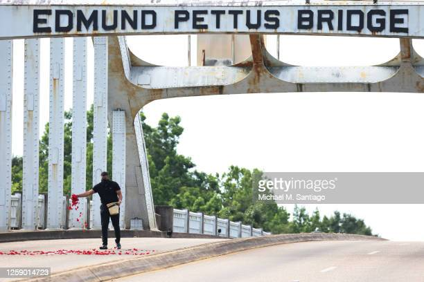 Rose petals are spread on the Edmund Pettus Bridge in preparation for the crossing of the hearse carrying the body of civil rights icon, former US...
