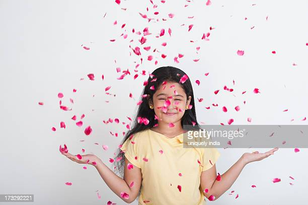 Rose petals falling on a girl